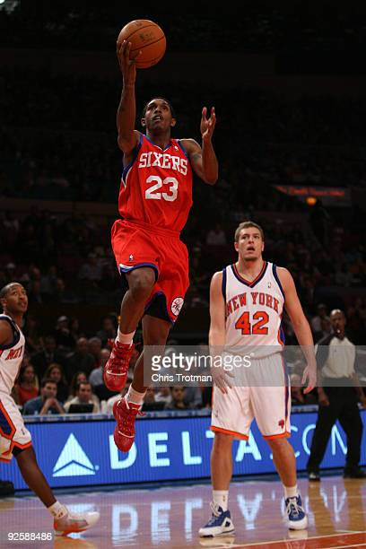 Lou Williams of the the Philadelphia 76ers drives to the basket past David Lee of the New York Knicks at Madison Square Garden on October 31 2009 in...