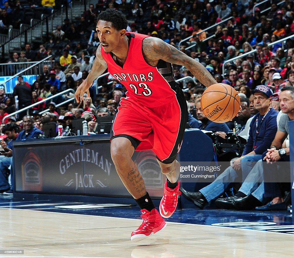 Lou Williams of the Toronto Raptors drives against the Atlanta Hawks on November 26 2014 at Philips Arena in Atlanta Georgia NOTE TO USER User...