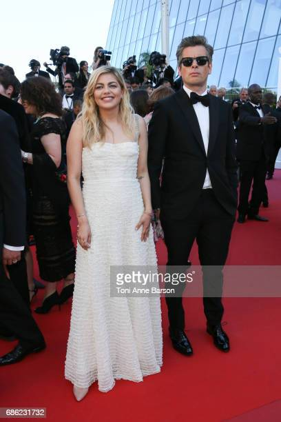 Louane Emera and Benjamin Biolay attend the 'Ismael's Ghosts ' screening and Opening Gala during the 70th annual Cannes Film Festival at Palais des...