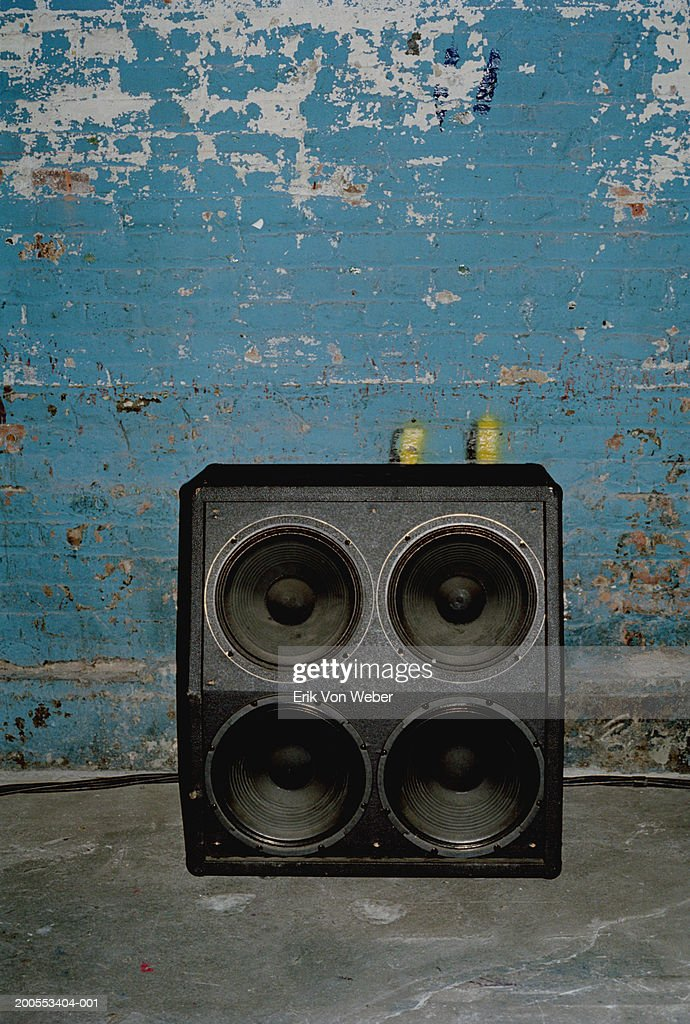 Loudspeaker in front of old wall : Stock Photo