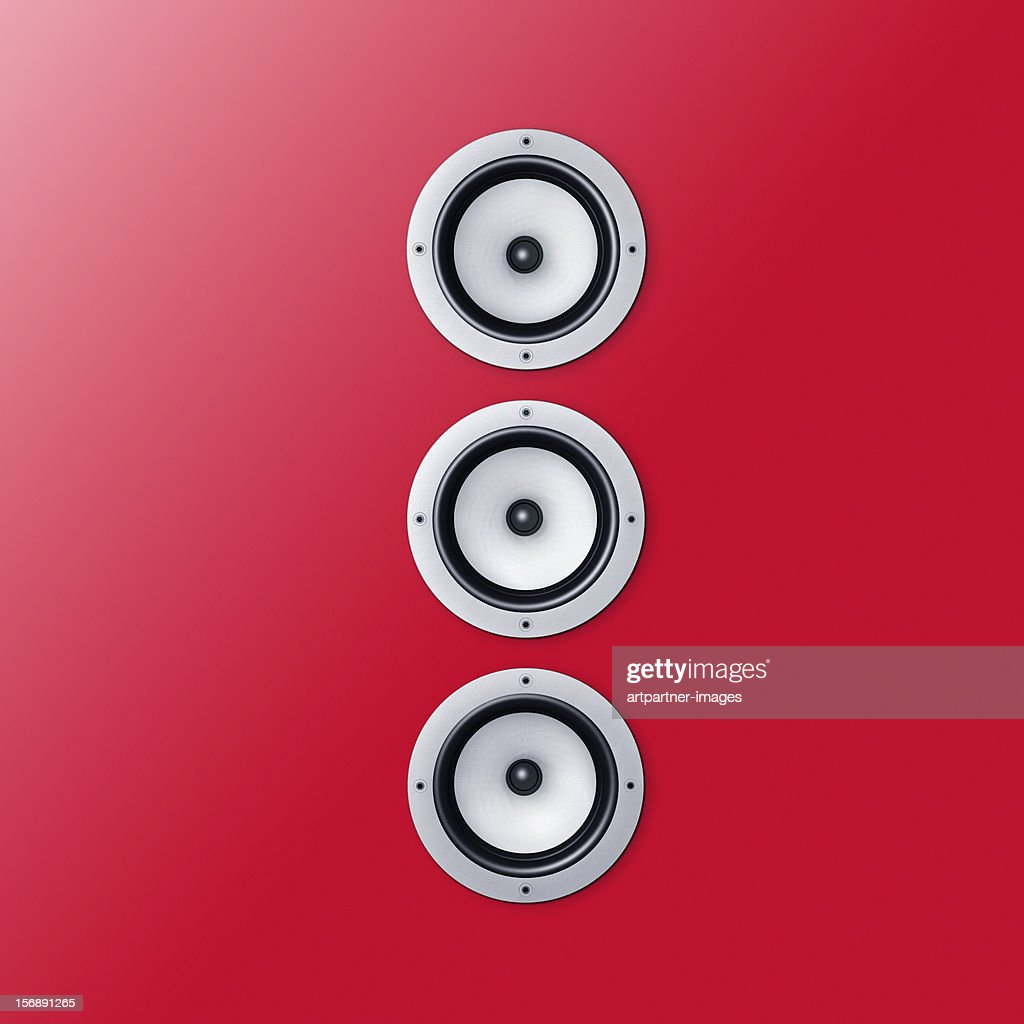 3 loudspeaker / speaker on a red wall : Stock Photo