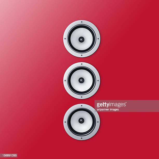 3 loudspeaker / speaker on a red wall