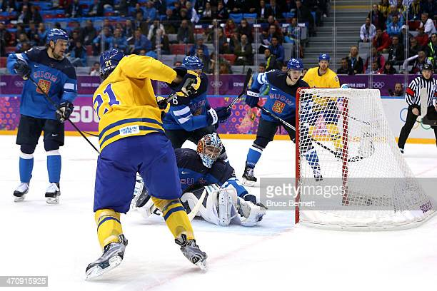 Loui Eriksson of Sweden shoots and scores against Kari Lehtonen of Finland in the second period during the Men's Ice Hockey Semifinal Playoff on Day...