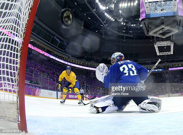 Loui Eriksson of Sweden shoots and scores against Robert Kristan of Slovenia in the third period during the Men's Ice Hockey Quarterfinal Playoff on...