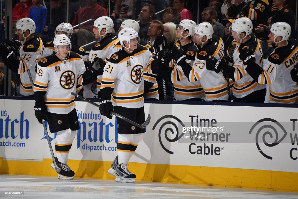 <a gi-track='captionPersonalityLinkClicked' href=/galleries/search?phrase=Loui+Eriksson&family=editorial&specificpeople=2235241 ng-click='$event.stopPropagation()'>Loui Eriksson</a> #21 of the Boston Bruins celebrates his third period goal with his fellow teammates on October 12, 2013 at Nationwide Arena in Columbus, Ohio. Boston defeated Columbus 3-1.