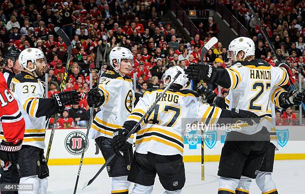 Loui Eriksson of the Boston Bruins celebrates with teammates after scoring Boston's second goal in the first period against the Chicago Blackhawks...