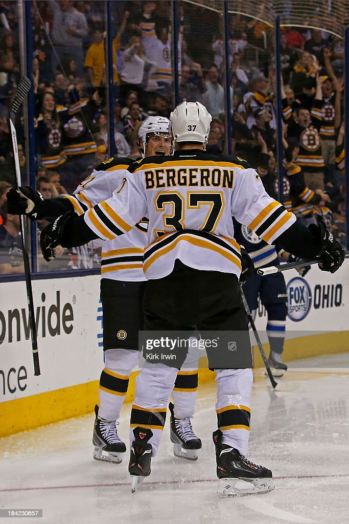 <a gi-track='captionPersonalityLinkClicked' href=/galleries/search?phrase=Loui+Eriksson&family=editorial&specificpeople=2235241 ng-click='$event.stopPropagation()'>Loui Eriksson</a> #21 of the Boston Bruins is congratulated by <a gi-track='captionPersonalityLinkClicked' href=/galleries/search?phrase=Patrice+Bergeron&family=editorial&specificpeople=204162 ng-click='$event.stopPropagation()'>Patrice Bergeron</a> #37 of the Boston Bruins after scoring the game winning goal against the Columbus Blue Jackets on October 12, 2013 at Nationwide Arena in Columbus, Ohio. Boston defeated Columbus 3-1.