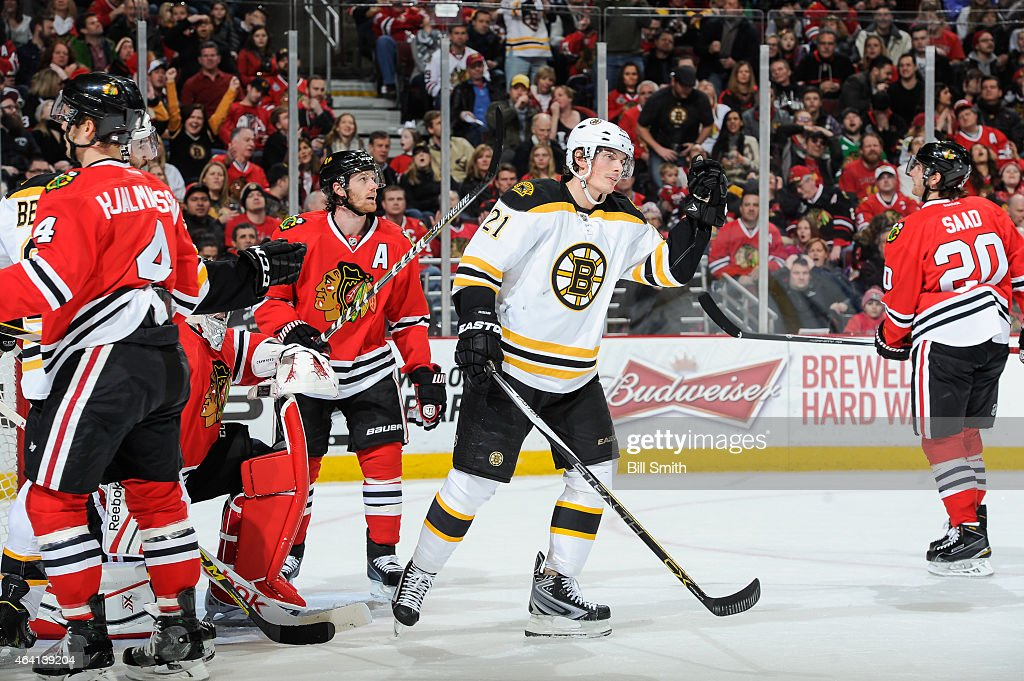 <a gi-track='captionPersonalityLinkClicked' href=/galleries/search?phrase=Loui+Eriksson&family=editorial&specificpeople=2235241 ng-click='$event.stopPropagation()'>Loui Eriksson</a> #21 of the Boston Bruins reacts after scoring Boston's second goal in the first period as <a gi-track='captionPersonalityLinkClicked' href=/galleries/search?phrase=Duncan+Keith&family=editorial&specificpeople=4194433 ng-click='$event.stopPropagation()'>Duncan Keith</a> #2 of the Chicago Blackhawks stands behind during the NHL game at the United Center on February 22, 2015 in Chicago, Illinois.