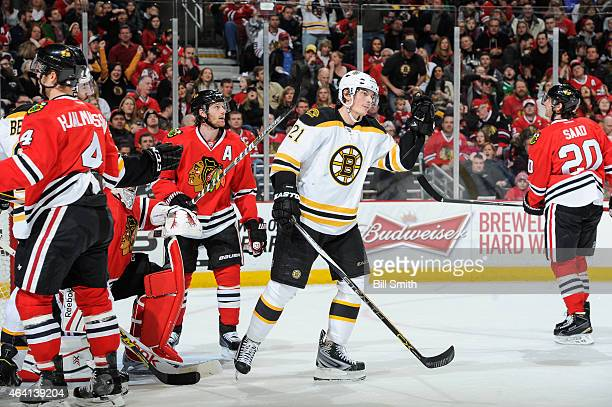 Loui Eriksson of the Boston Bruins reacts after scoring Boston's second goal in the first period as Duncan Keith of the Chicago Blackhawks stands...