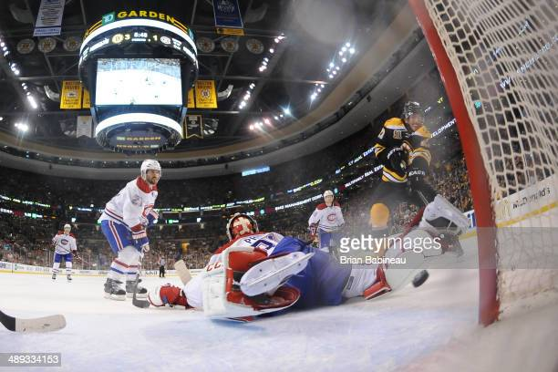 Loui Eriksson of the Boston Bruins scores a goal against Carey Price of the Montreal Canadiens in Game Five of the Second Round of the 2014 Stanley...