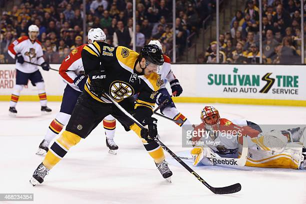 Loui Eriksson of the Boston Bruins scores a goal against Roberto Luongo of the Florida Panthers during the first period at TD Garden on March 31 2015...