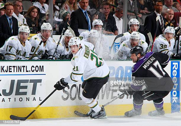 Loui Eriksson of the Dallas Stars handles the puck against Ethan Moreau of the Los Angeles Kings at the American Airlines Center on November 23 2011...