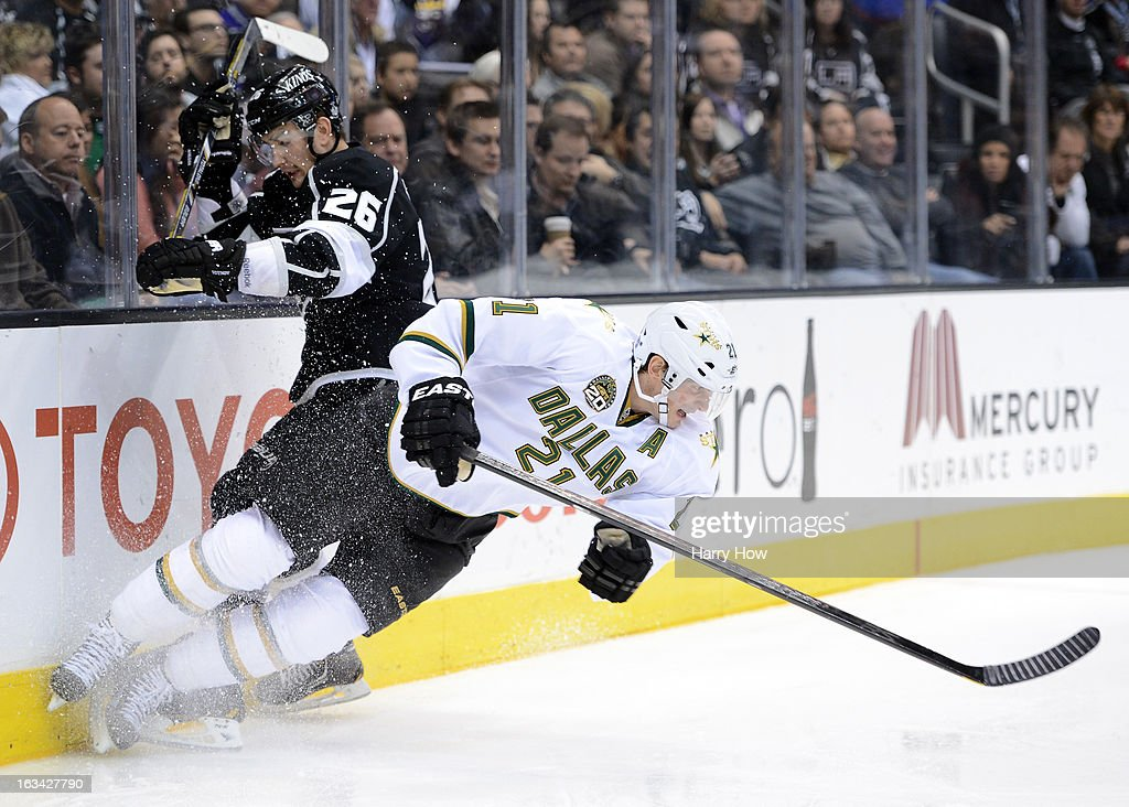 <a gi-track='captionPersonalityLinkClicked' href=/galleries/search?phrase=Loui+Eriksson&family=editorial&specificpeople=2235241 ng-click='$event.stopPropagation()'>Loui Eriksson</a> #21 of the Dallas Stars is checked to the ice by <a gi-track='captionPersonalityLinkClicked' href=/galleries/search?phrase=Slava+Voynov&family=editorial&specificpeople=8315719 ng-click='$event.stopPropagation()'>Slava Voynov</a> #26 of the Los Angeles Kings at Staples Center on March 7, 2013 in Los Angeles, California.