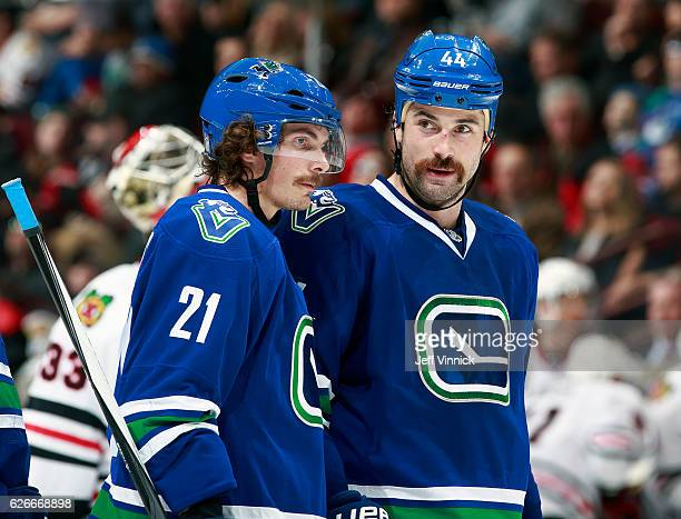 Loui Eriksson of the Vancouver Canucks talks to teammate Erik Gudbranson during their NHL game against the Chicago Blackhawks at Rogers Arena...