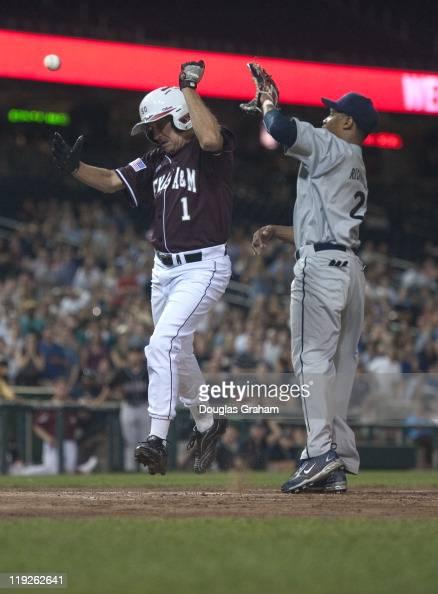Louie Gohmert RTX scores a run as Cedric Richmond DLA waits for the ball at home plate during the 50th Annual Roll Call Congressional Baseball Game...