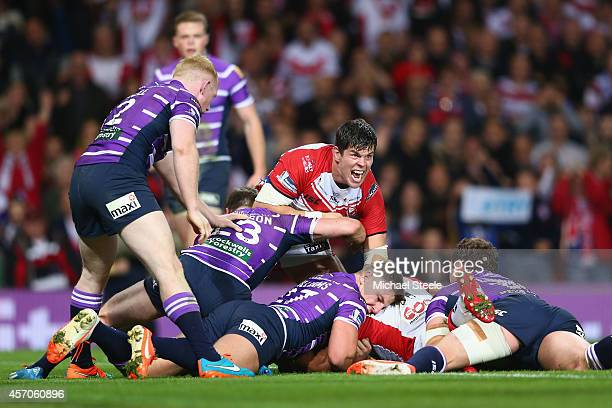 Louie McCarthyScarsbrook of St Helens celebrates his sides opening try scored by Sia Soliola during the First Utility Super League Grand Final match...