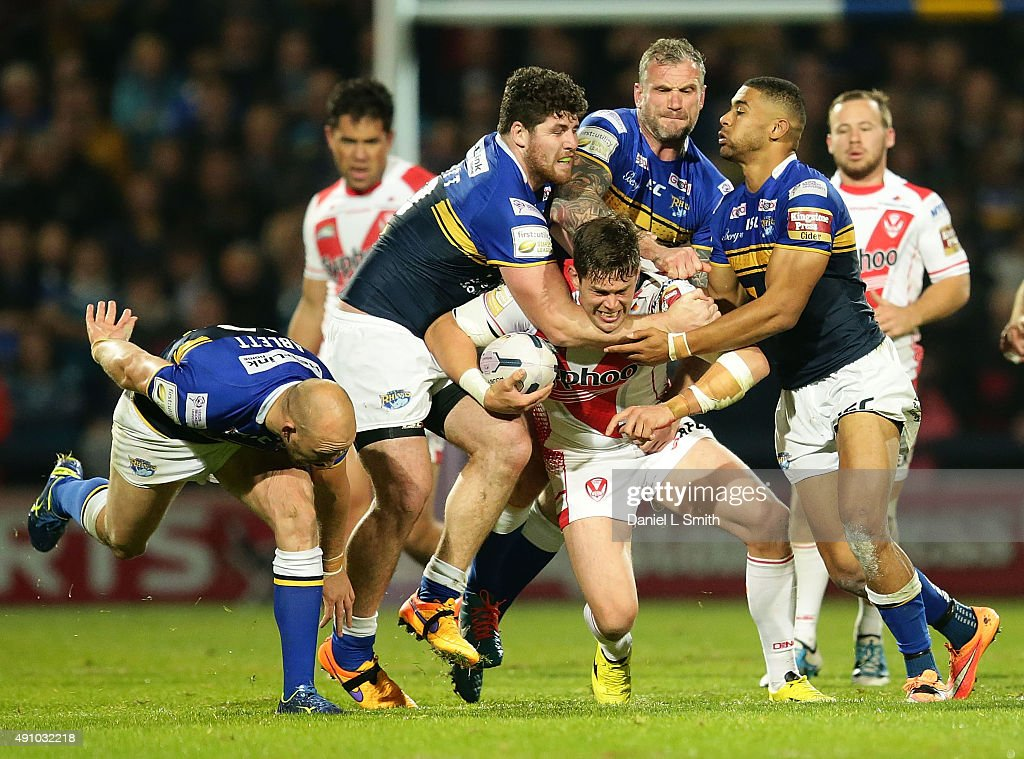 Louie McCarthyScarsbrook of St Helens RFC in a hard tackle from Mitch Garbutt Kallum Watkins and Jamie Peacock of Leeds Rhinos during the First...