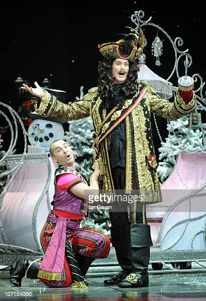 Louie Spence and David Hasselhoff attend the First Family Entertainment Pantomime photocall at the Piccadilly Theatre on November 26 2010 in London...