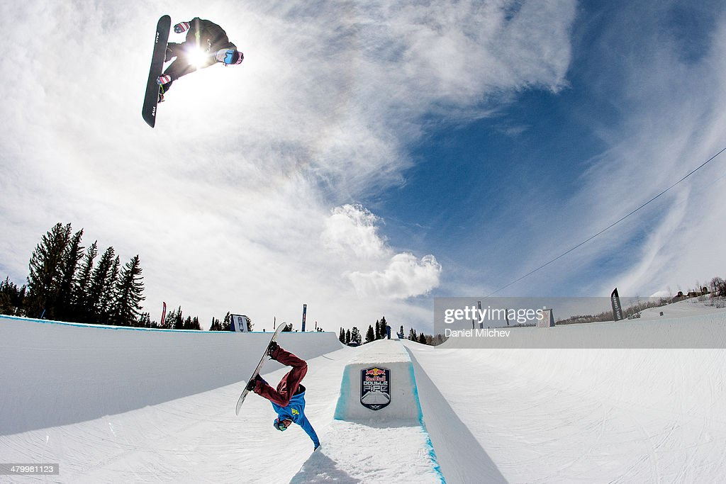 Louie Vito and a snowboarding coach in action during practice at Red Bull Double Pipe on March 21 2014 in Aspen Colorado