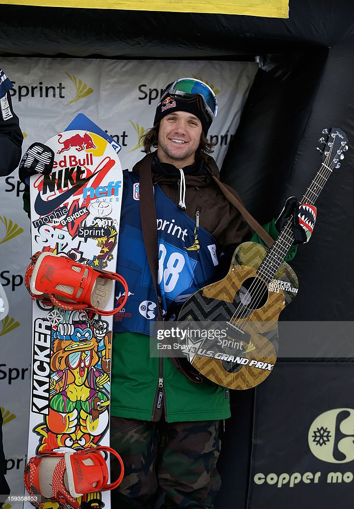 Louie Vito stands on the podium after placing third in the FIS Snowboard World Cup Half Pipe men's finals at the US Grand Prix on January 12, 2013 in Copper Mountain, Colorado.
