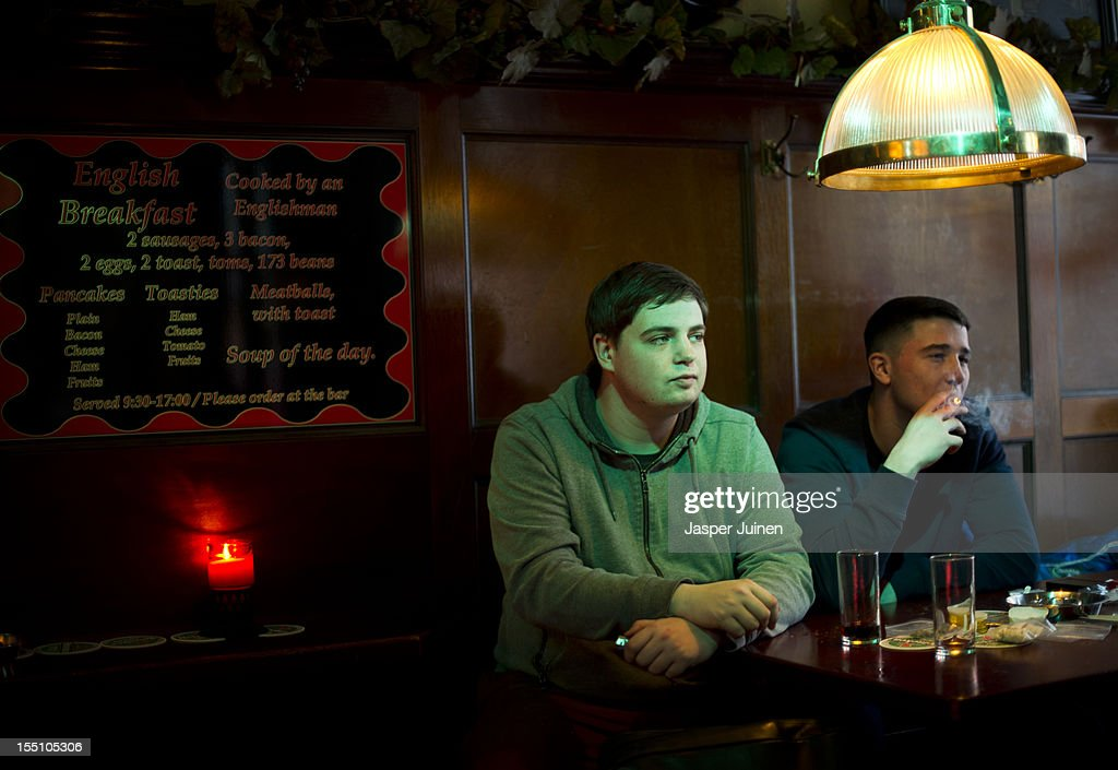 Louis (R), 22 years old from Manchester, smokes cannabis in a coffee shop with his friend Josh, 21 years old from Manchester, on November 1, 2012 in the center of Amsterdam, Netherlands. Coffee shops in the Dutch captial will remain open to tourists after its mayor, Eberhard van der Laan, decided that tourists will not be banned from the 220 coffee shops in Amsterdam where marijuana and hashish are openly sold and consumed. The decision came after the new government of the Netherlands stated that it would be up to local authorities to decide whether or not to impose a ban on cannabis.