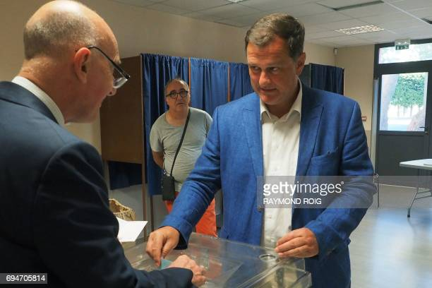 Louis Aliot candidate of the far right National Front party in the 2nd district of the Pyrenees orientales casts his vote at a polling station during...