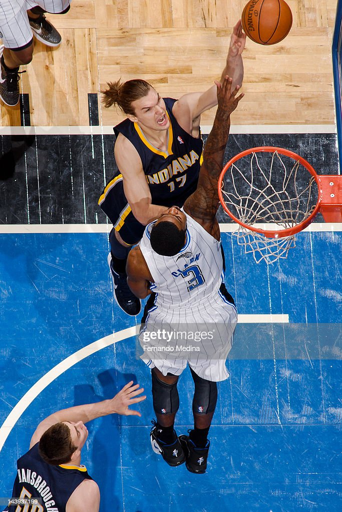 <a gi-track='captionPersonalityLinkClicked' href=/galleries/search?phrase=Louis+Amundson&family=editorial&specificpeople=757157 ng-click='$event.stopPropagation()'>Louis Amundson</a> #17 of the Indiana Pacers goes for a layup against Earl Clark #3 of the Orlando Magic in Game Four of the Eastern Conference Quarterfinals during the 2012 NBA Playoffs on May 5, 2012 at Amway Center in Orlando, Florida.