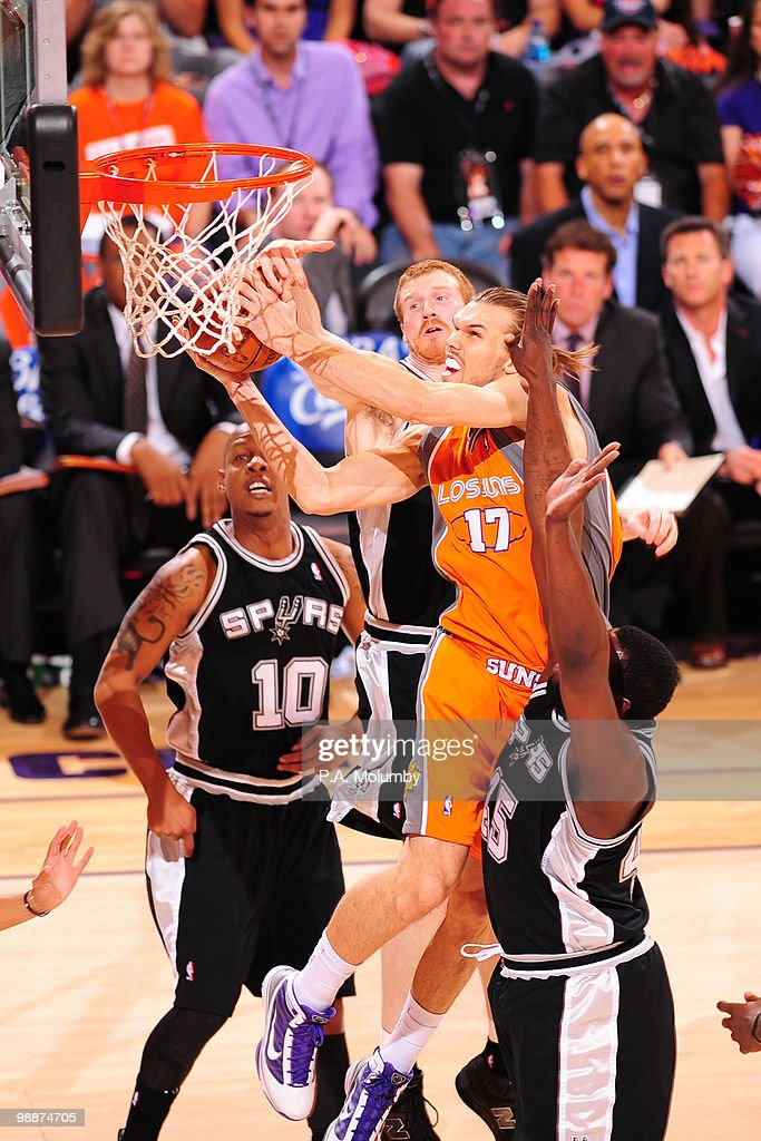 Louis Amundson #17 of the Phoenix Suns drives for a shot between Keith Bogans #10 and Matt Bonner #15 in Game Two of the Western Conference Semifinals during the 2010 NBA Playoffs on May 5, 2010 at U.S. Airways Center in Phoenix, Arizona. The Suns are wearing their 'Los Suns' jerseys in response to an illegal-immigration law signed into law by the governor.