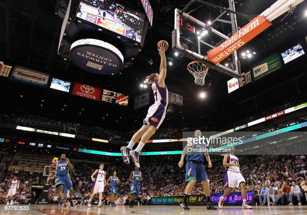 Louis Amundson of the Phoenix Suns slam dunks the ball over Oleksiy Pecherov of the Minnesota Timberwolves during the NBA game at US Airways Center...