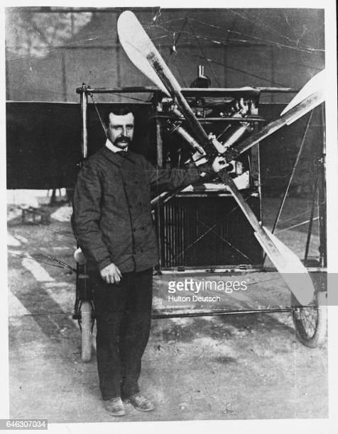 Louis Bleriot the French inventor and aviator beside an early propeller aircraft He 1909 he became the first man to fly across the English Channel
