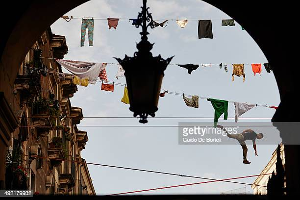 Louis Boniface of France at the Red Bull Airlines and THE WALK Movie Freestyle Slackline Competition above the balconies in Catania Sicily #TheWalk...
