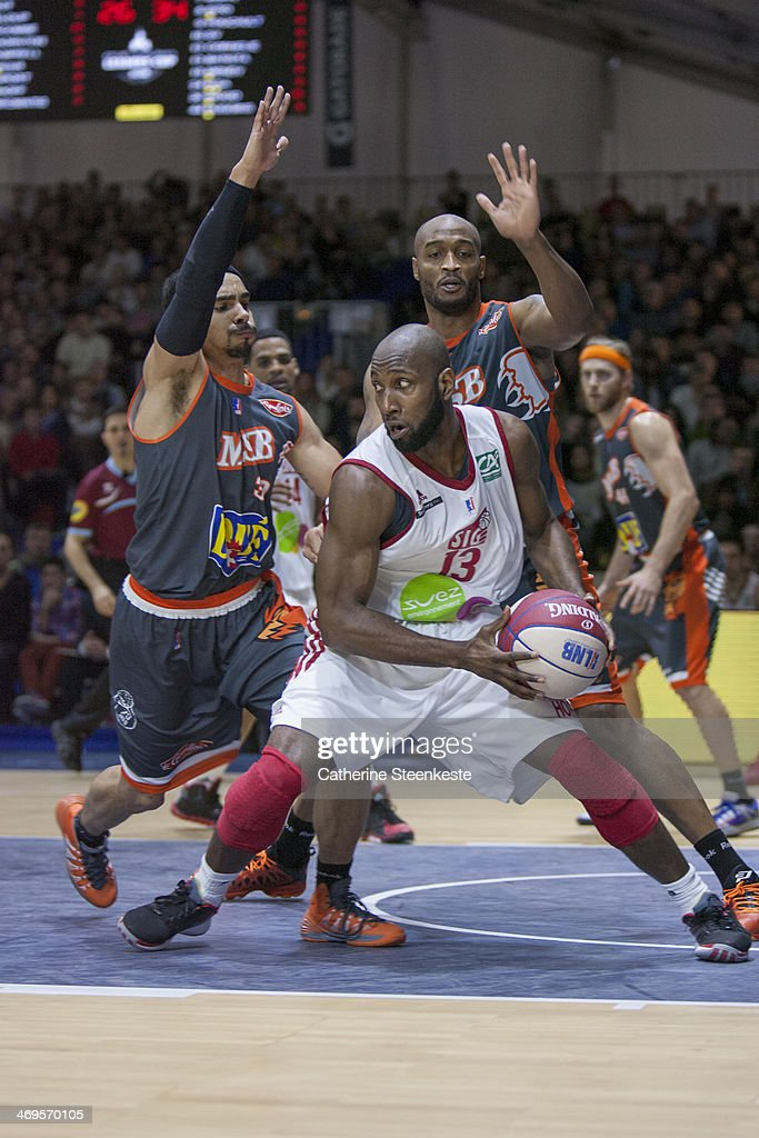 Louis Campbell of Strasbourg is trying to pass the ball against DaShaun Wood and Reyshawn Terry of Le Mans during the game between Strasbourg and Le...