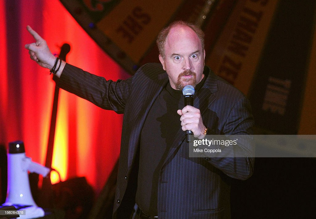 Louis C.K. performs onstage at the 2012 A Funny Thing Happened On The Way To Cure Parkinson's event at The Waldorf=Astoria on November 10, 2012 in New York City benefitting The Michael J. Fox Foundation for Parkinson's Research.