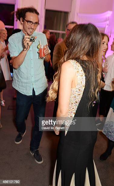 Louis Cole and Zoe Sugg attend YouTube phenomenon Zoe Sugg's launch of her debut beauty collection at 41 Portland Place on September 25 2014 in...