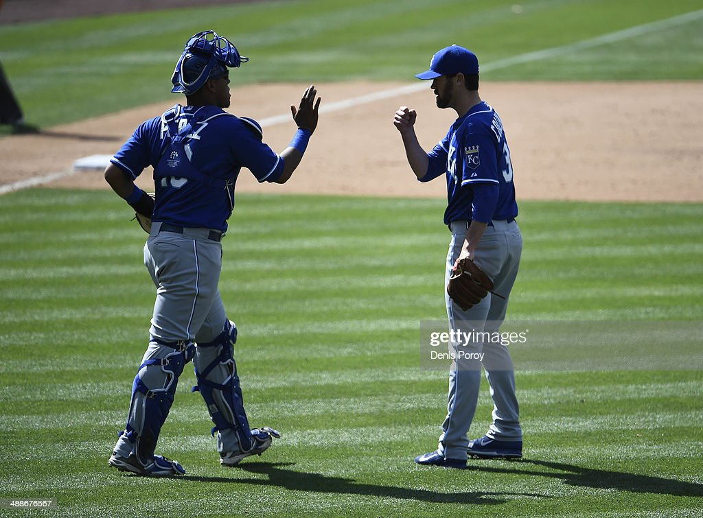 Louis Coleman #31 of the Kansas City Royals, right, is congratulated by Salvador Perez #13 after getting the final out during the ninth inning of a baseball game against the San Diego Padres at Petco Park May 7, 2014 in San Diego, California. The Royals won 8-0.