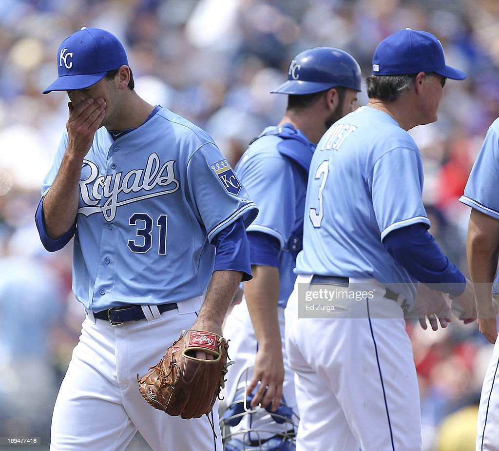 Louis Coleman #31 of the Kansas City Royals wipes his face as he leaves a game in the eighth inning against the Los Angeles Angels of Anaheim at Kauffman Stadium on May 25, 2013 in Kansas City, Missouri.