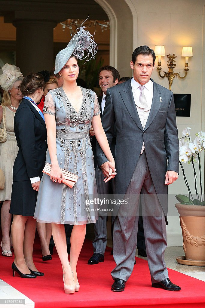 H. Louis de Bourbon, Duke of Anjou and his wife Maria Margarita Vargas Santaella are sighted leaving the 'Hermitage' hotel to attend the Royal Wedding of <a gi-track='captionPersonalityLinkClicked' href=/galleries/search?phrase=Prince+Albert+II+of+Monaco&family=editorial&specificpeople=201707 ng-click='$event.stopPropagation()'>Prince Albert II of Monaco</a> to <a gi-track='captionPersonalityLinkClicked' href=/galleries/search?phrase=Charlene+-+Princess+of+Monaco&family=editorial&specificpeople=726115 ng-click='$event.stopPropagation()'>Charlene</a> Wittstock in the main courtyard at on July 2, 2011 in Monaco, Monaco.