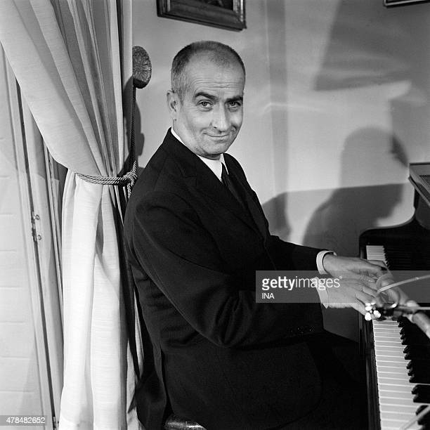 Louis de Funes at his home playing the piano on the occasion of an interview for the television news