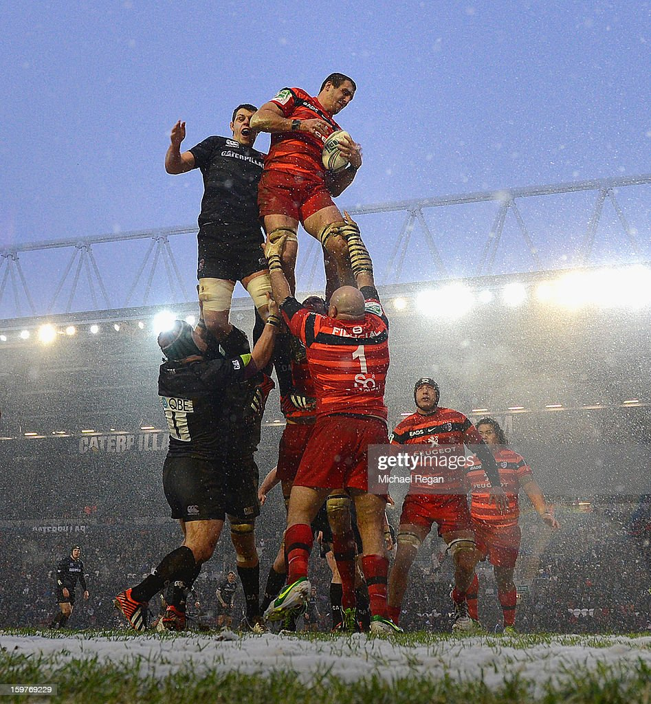 Louis Deacon of Leicester Tigers jumps for a line out with Yoann Maestri of Toulouse during the Heineken Cup match between Leicester Tigers and Toulouse at Welford Road on January 20, 2013 in Leicester, England.