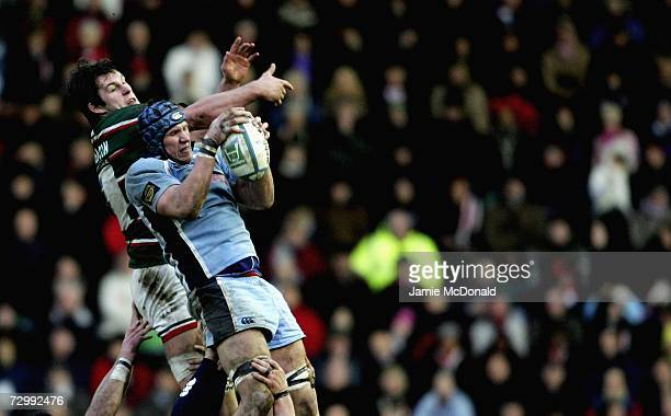 Louis Deacon of Leicester Tigers jumps with Ben White of Cardiff Blues during the Heineken Cup Pool Four match between Leicester Tigers and Cardiff...