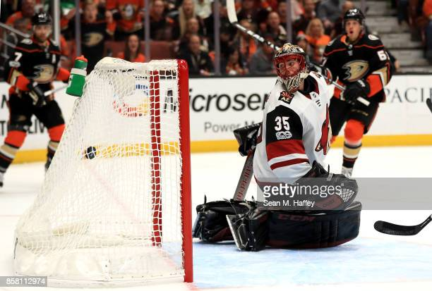 Louis Domingue of the Arizona Coyotes is unable to stop a goal by Rickard Rakell of the Anaheim Ducks during the third period of a game at Honda...