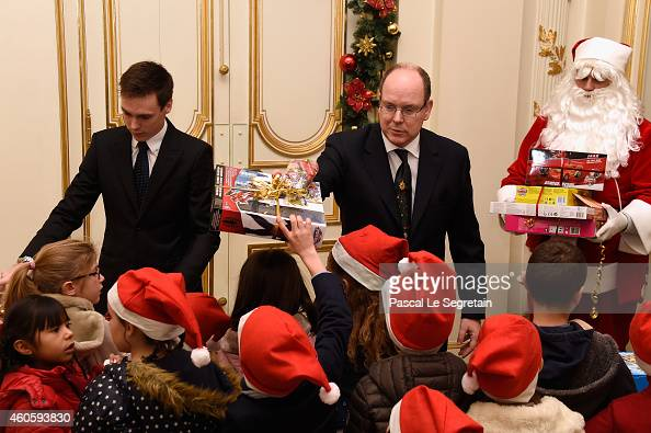 Louis Ducruet and Prince Albert II of Monaco attend the Christmas gifts distribution in the Monaco Palace on December 17 2014 in Monaco Monaco