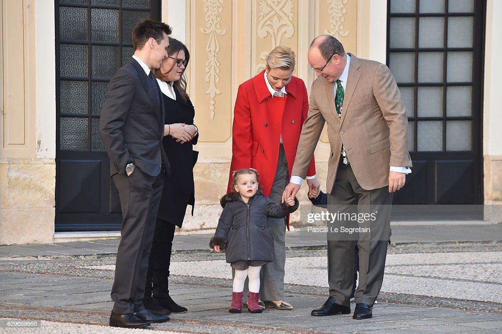 Louis Ducruet, Camille Gottlieb, Princess Gabriella of Monaco, Princess Charlene Of Monaco and Prince Albert II of Monaco attend the annual Christmas gifts distribution at Monaco Palace on December 14, 2016 in Monaco, Monaco.