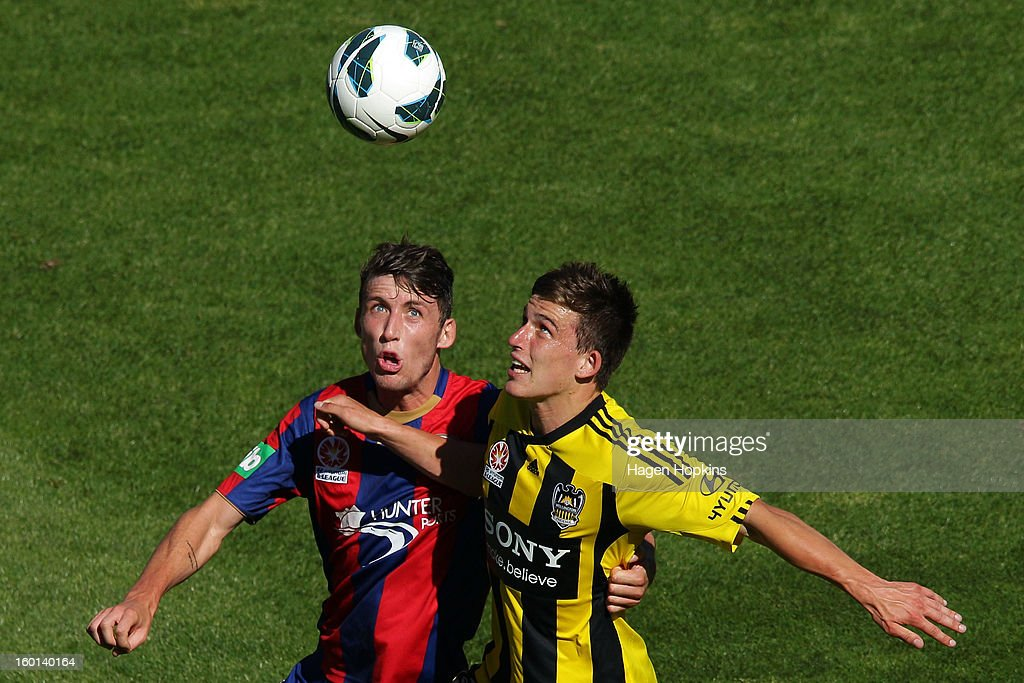 Louis Fenton of the Phoenix and Scott Neville of the Jets compete for the ball during the round 18 A-League match between the Wellington Phoenix and the Newcastle Jets at Westpac Stadium on January 27, 2013 in Wellington, New Zealand.