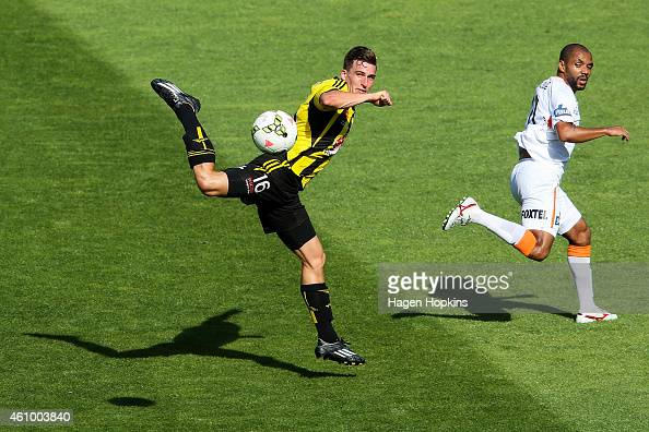 Louis Fenton of the Phoenix attempts to control the ball while Henrique of the Roar looks on during the round 15 ALeague match between the Wellington...