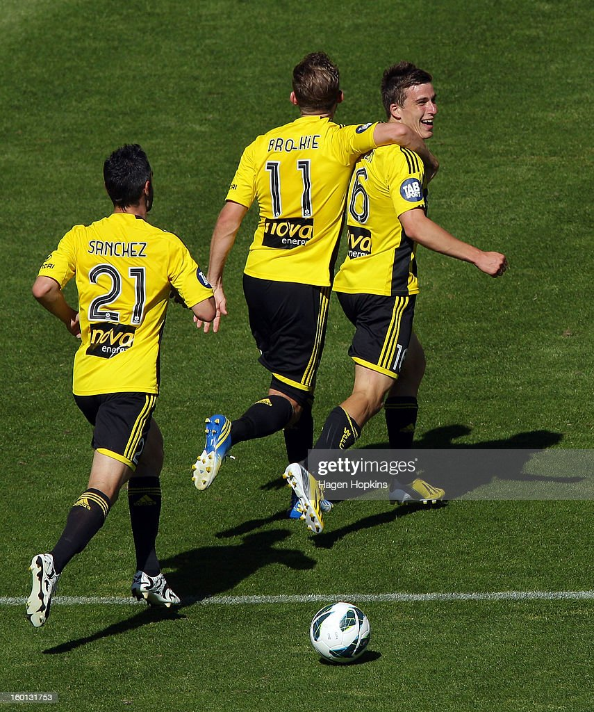 Louis Fenton of the Phoenix celebrates his goal with teammates Jeremy Brockie and Dani Sanchez during the round 18 A-League match between the Wellington Phoenix and the Newcastle Jets at Westpac Stadium on January 27, 2013 in Wellington, New Zealand.