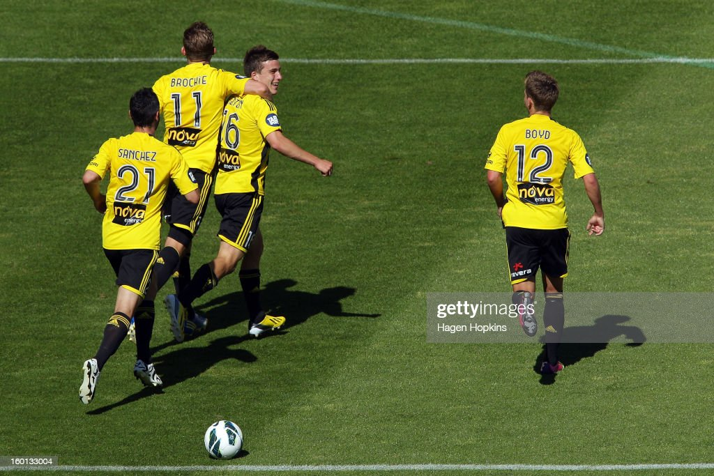 Louis Fenton of the Phoenix celebrates his goal with teammates Jeremy Brockie, Dani Sanchez and Tyler Boyd during the round 18 A-League match between the Wellington Phoenix and the Newcastle Jets at Westpac Stadium on January 27, 2013 in Wellington, New Zealand.