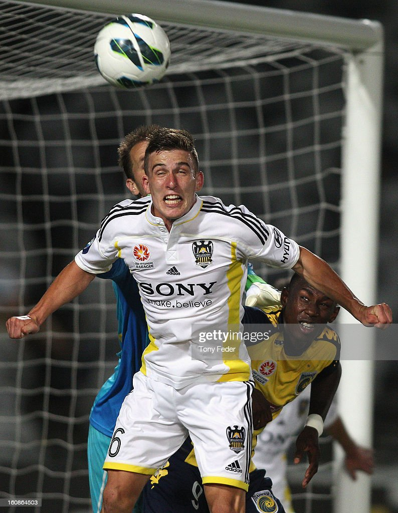 Louis Fenton of the Phoenix heads the ball clear during the round 20 A-League match between the Central Coast Mariners and the Wellington Phoenix at Bluetongue Stadium on February 7, 2013 in Gosford, Australia.