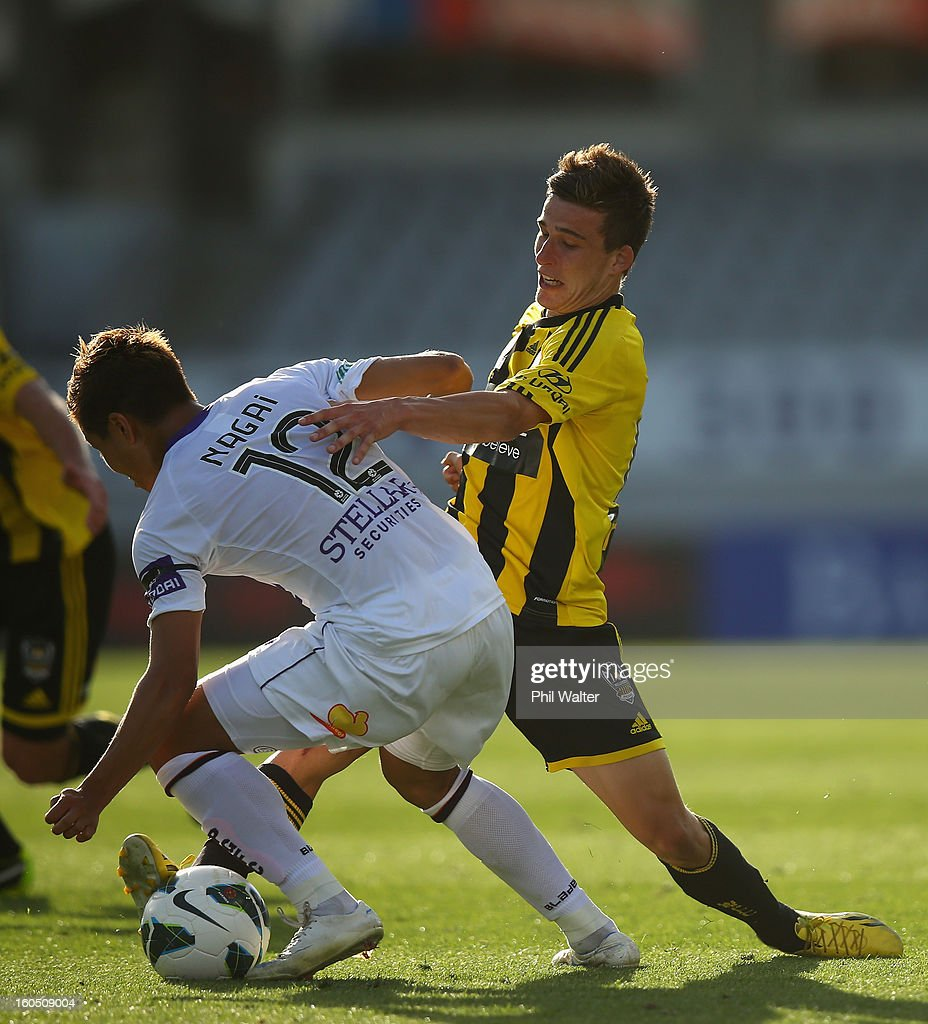 Louis Fenton of the Phoenix holds back Ryo Nagai of Perth during the round 19 A-League match between the Wellington Phoenix and the Perth Glory at Eden Park on February 2, 2013 in Auckland, New Zealand.