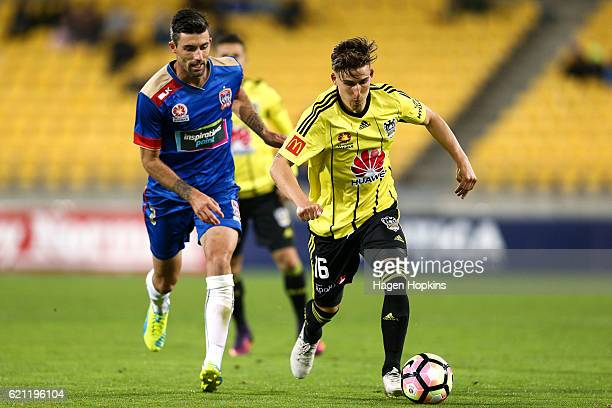 Louis Fenton of the Phoenix holds off the challenge of Jason Hoffman of the Jets during the round five ALeague match between the Wellington Phoenix...